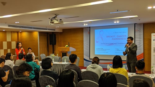 Dr Tang at a workshop in Vietnam sharing about Breast Cancer