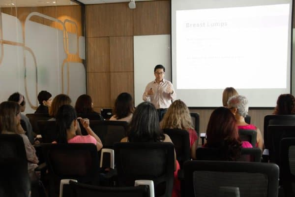 Dr Tang at Business Women Network Asia sharing on breast cancer awareness.